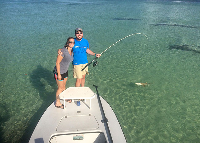 Barbara and her boyfriend pleased about their first time fly fishing in Cozumel.