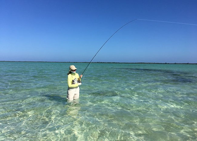 Raquel fly fishing in Cozumel with her friends and family.